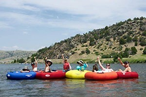 Madison River Tubing Trips-Feet Up, Shades On! $20 :: Enjoy a leisurely river float in a tube! Stay cool & have fun with the family. Trip includes shuttle, tube & optional floating cooler & PFD. Departures daily from Bozeman.